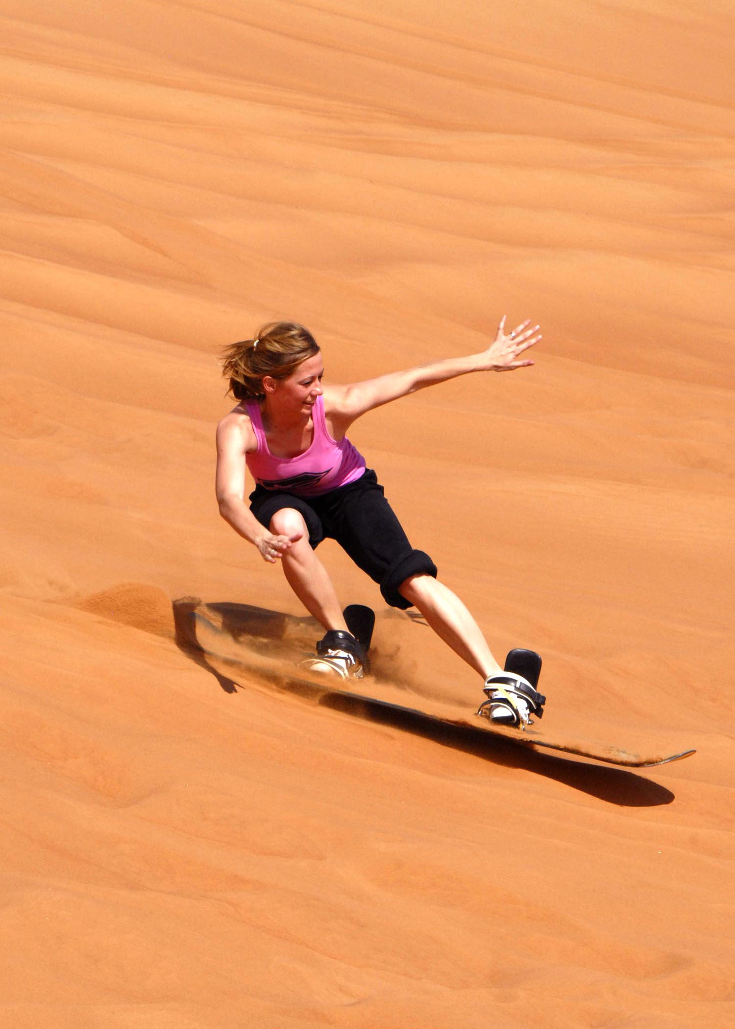 Sandboarding - Sandsurfing in desert Morocco